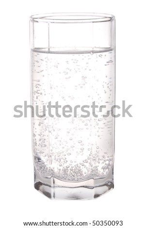 Glass of sparkling mineral water isolated on white background - stock photo