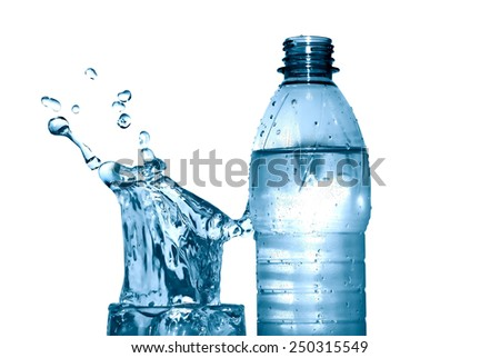Glass of splashing water near plastic bottle on white background. Clipping path is included - stock photo