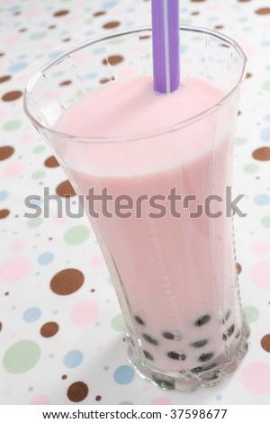 Glass of strawberry flavored pearl milk tea. - stock photo