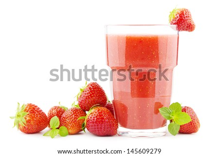 Glass of strawberry smoothie with strawberries - stock photo