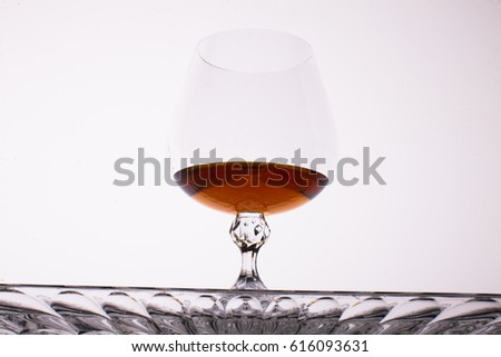 Glass of strong alcoholic drink cognac