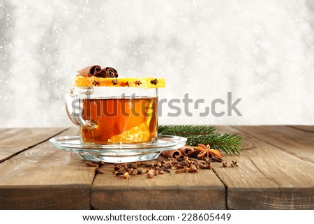 glass of tea and table of wood - stock photo