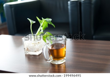 Glass of tea on table in a conference room.