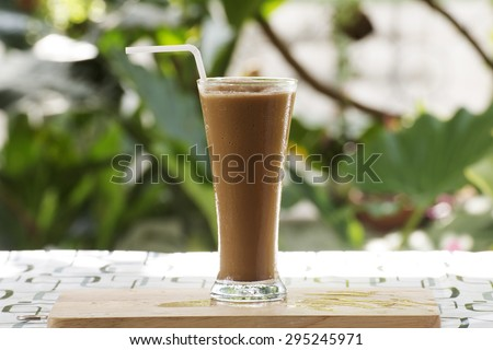 Glass of Thai Coffee smoothie on the table - stock photo