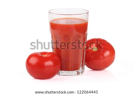 Glass of tomato juice - stock photo