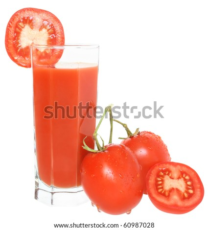 Glass of tomato juice and two tomatoes.