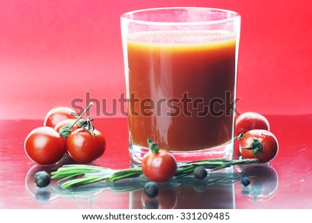 glass of tomato juice drops