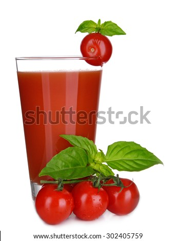 Glass of tomato juice with green leaves isolated on white