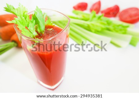 Glass of tomato juice with selery, pepper, carrot and tomatoes