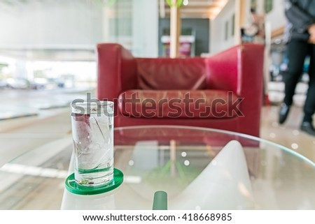 Glass of very cold water - Water in a glass and blurry office interior background - stock photo
