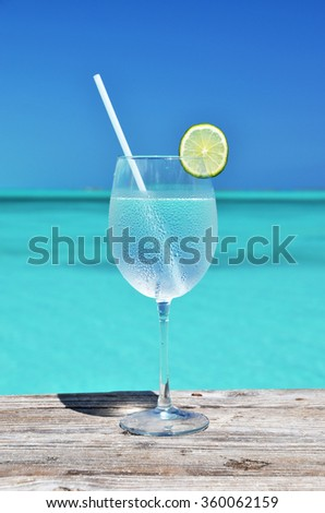 Glass of water against blue sky - stock photo