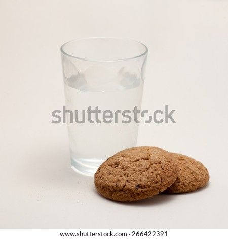 Glass of water and cookies - stock photo