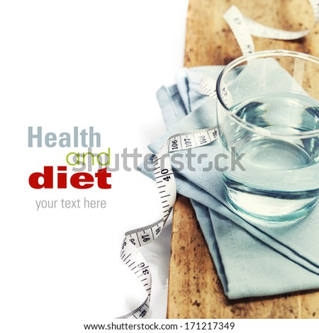 Glass of water and  measuring tape - healh and diet concept - over white (with easy removable sample text) - stock photo