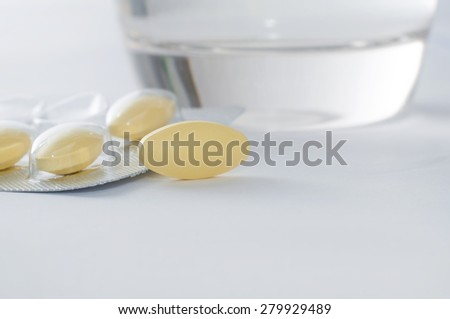 Glass of water and pills - stock photo