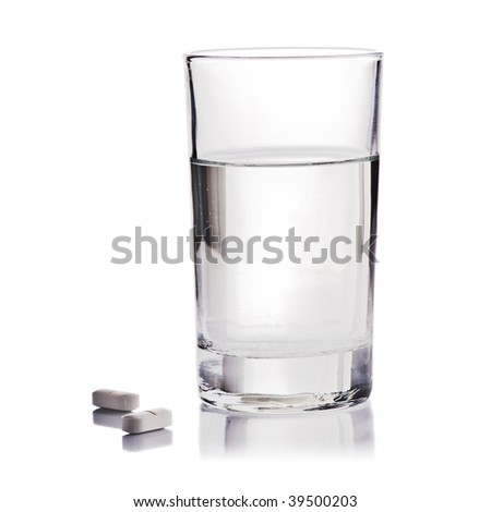 Glass of Water and Pills on white background - stock photo
