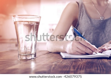 glass of water and woman hand  - stock photo