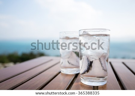 Glass of water at outdoor restaurant - stock photo
