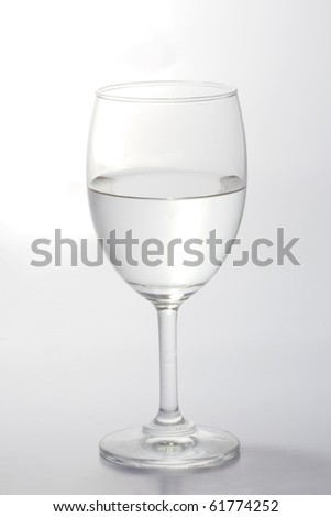Glass of water half empty isolated on white background - stock photo
