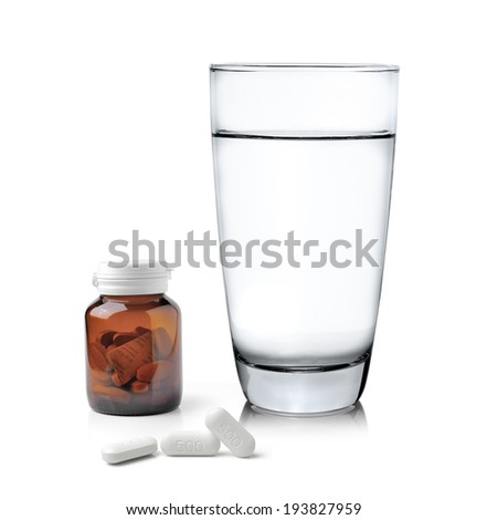 Glass of water Medicine bottle and pills isolated on white background - stock photo
