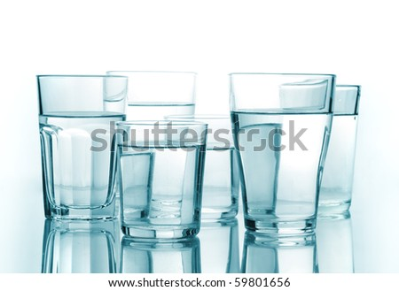 glass of water on a white isolated background - stock photo