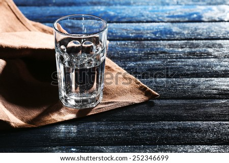 Glass of water on napkin close up - stock photo