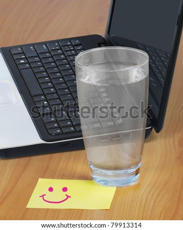 Glass of water on the table - stock photo
