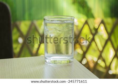glass of water on wood table - stock photo