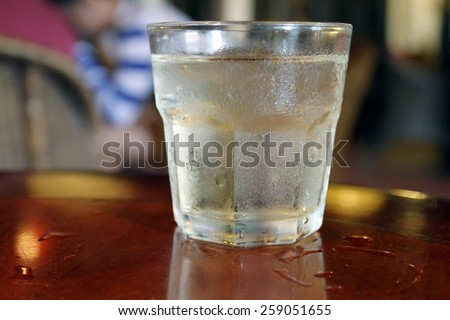 glass of water on wood table for drink at summer - stock photo