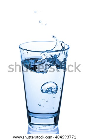 Glass of water splashing isolated on white background