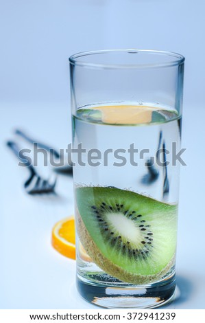 Glass of water with fruit