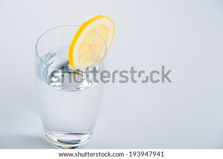 Glass of water with lemon, isolated
