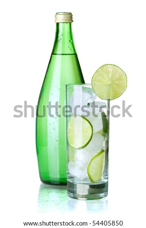Glass of water with lime, ice, mint and bottle with mineral water. Isolated on white background - stock photo