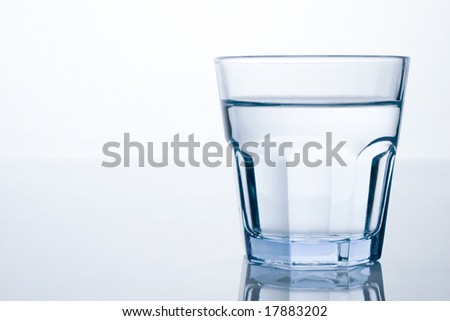 glass of water with space on the left - stock photo