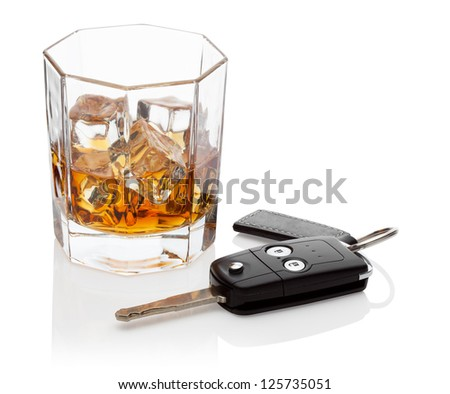 Glass of whiskey and car keys, isolated on the white background, clipping path included. - stock photo