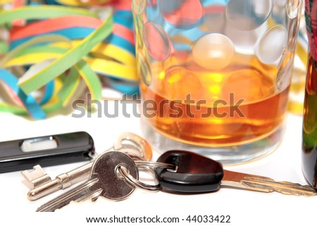 glass of whiskey and car keys on white background depicting drunk driving and addictions can kill - stock photo