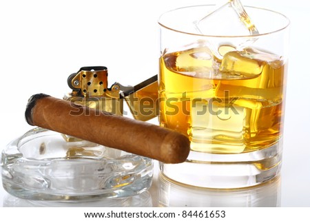 Glass of Whiskey and Cigar against white background