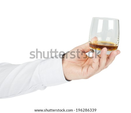 Glass of whiskey in his hand isolated on white background