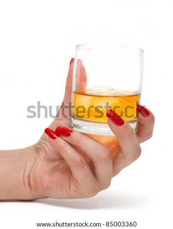 Glass of whiskey in the women's hand - stock photo