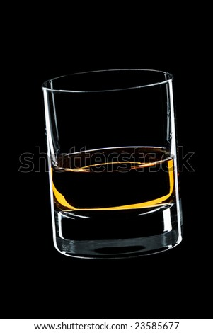glass of whiskey isolated over black background - stock photo