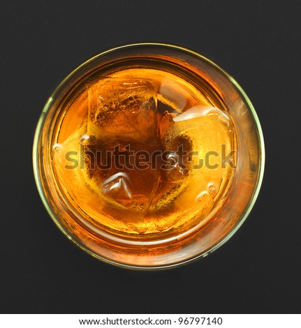 glass of whiskey on a black background - stock photo