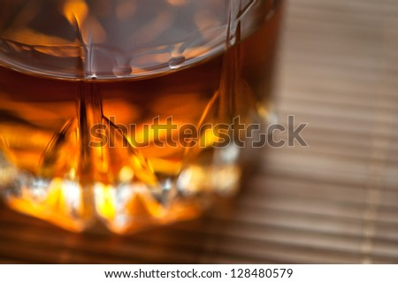glass of whiskey on table - stock photo