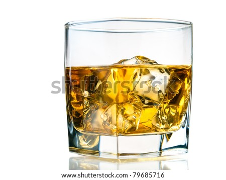 Glass of whiskey on the rocks, isolated on white