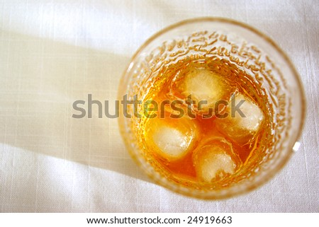 glass of whiskey on the rocks seen from above - stock photo