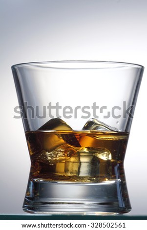 Glass of whiskey / whiskey on the rocks glass isolated on white background