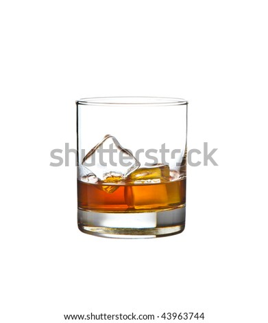 glass of whiskey with ice - stock photo