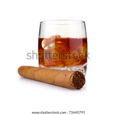 Glass of whiskey with ice cubes and havana cigar isolated on white background