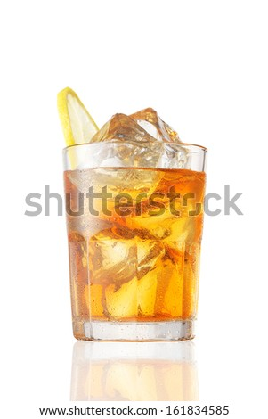 Glass of whiskey with ice on a white background - stock photo