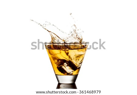 Glass of whiskey with splash, isolated on white background - stock photo