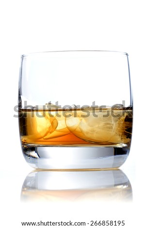 Glass of whisky on white background - stock photo