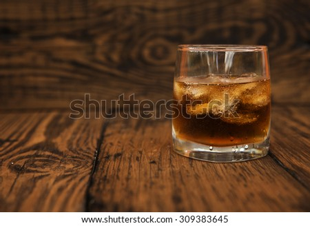 Glass of whisky with ice.